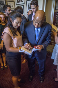 Congressman Lewis signs CeCe's book.
